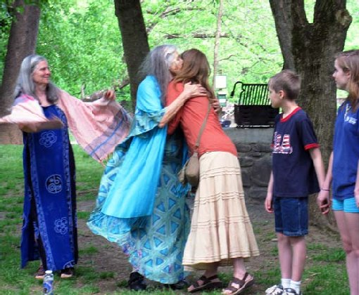 Antiga, Asheville's Beloved Crone, hugs a young mother at the 2010 Beltane Ritual.